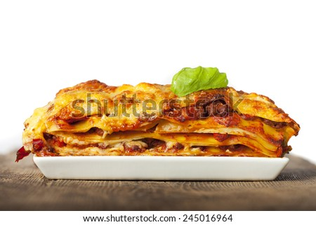 lasagna on a white plate  - stock photo