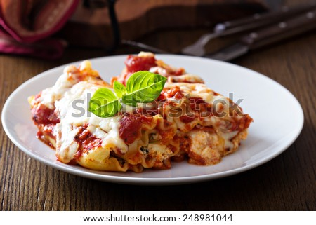 Lasagna rolls with tomato sauce, ricotta and pepperoni - stock photo