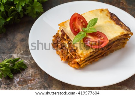 Lasagna, traditional Italian food on a wooden background
