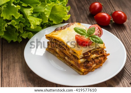 Lasagna, traditional Italian food on a wooden background - stock photo