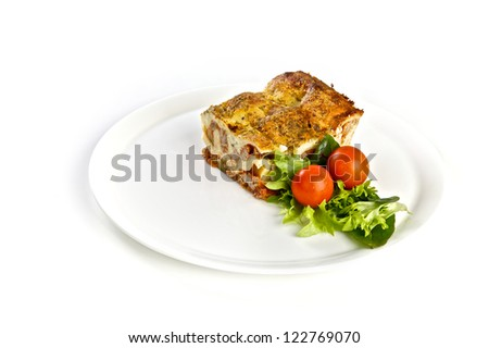 Lasagna with a salad on a plate, lunch or dinner - stock photo