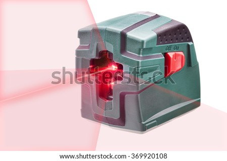 Laser Level measuring tool with visible red laser beam crossing - stock photo