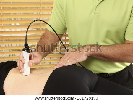 Laser physiotherapy - stock photo