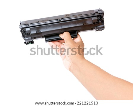 Laser printer cartridge in hand - stock photo