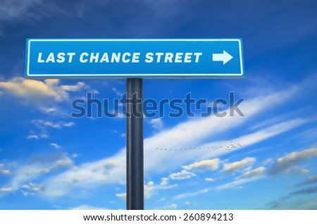 Last chance street slogan on the street sign against cloudy blue sky.