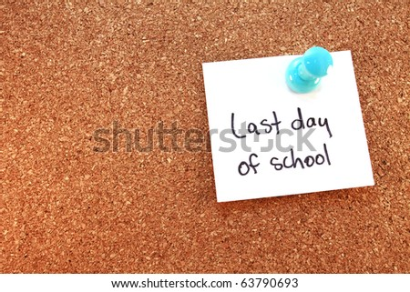 Last Day of School A last day of school note tacked on corkboard. Horizontal. - stock photo