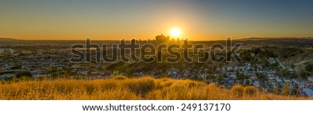 Last-minute scouting led to this fantastic viewpoint overlooking the metropolis of Los Angeles. This panorama comprises of 8 images. - stock photo