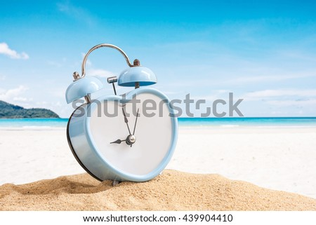 last minute to count down for travel metaphor by old retro clock on sand beach ,abstract background to time for summer vacation or travel vacation concept. - stock photo