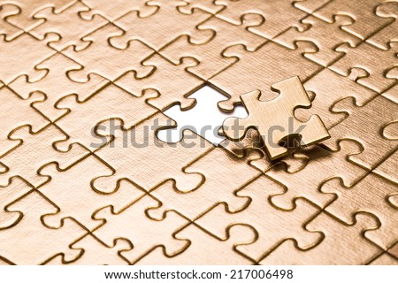 Last piece of jigsaw puzzle. - stock photo