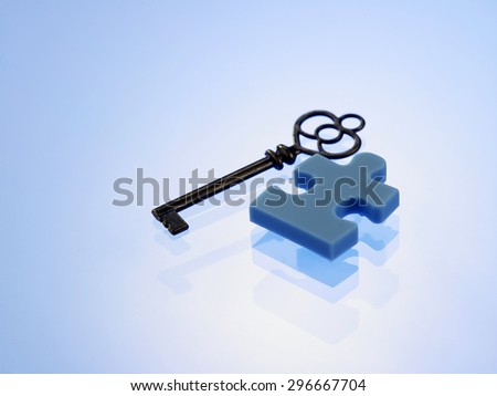 last piece of the jigsaw puzzle with key - stock photo