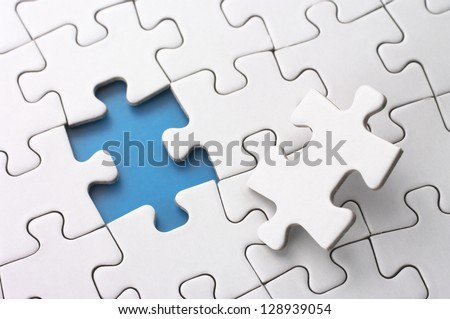 Last puzzle piece.Concept image of building and button up. - stock photo