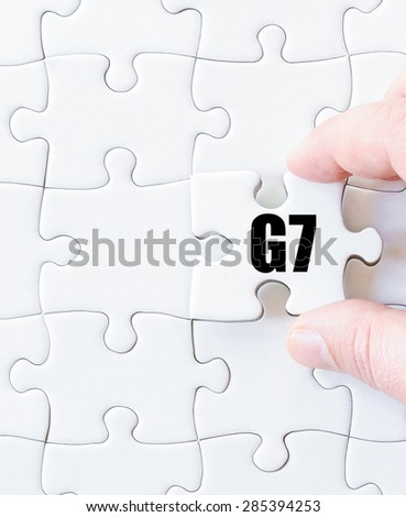 Last puzzle piece with word G7 SUMMIT. Concept image