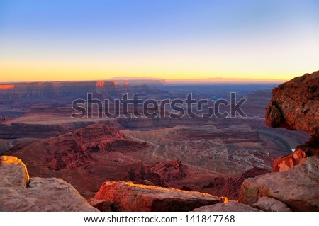 Last rays of light on Canyonlands viewed from Dead Horse Point, Utah - stock photo