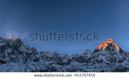 Last rays of sun on the top of the Mount Cervino in winter season, Aosta Valley - Italy - stock photo