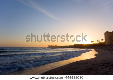 Last rays of sun streaming through Ventura ocean side promenade to the city beach, Southern California