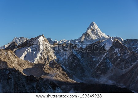 Last sun rays on the Ama Dablam (6814 m) at sunset (view from Kala Patthar (5600 m))- Everest region, Nepal, Himalayas - stock photo