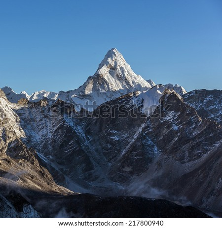 Last sun rays on the Ama Dablam (6814 m) at sunset (view from Kala Patthar (5600 m)) - Everest region, Nepal, Himalayas - stock photo
