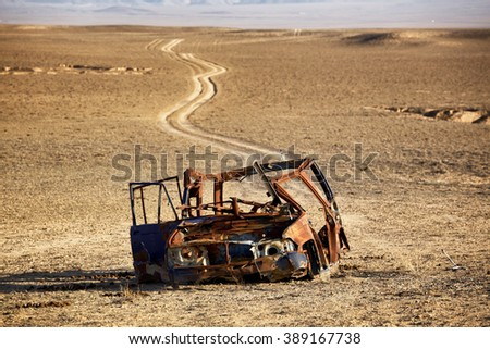 Last way for the car in the desert - stock photo
