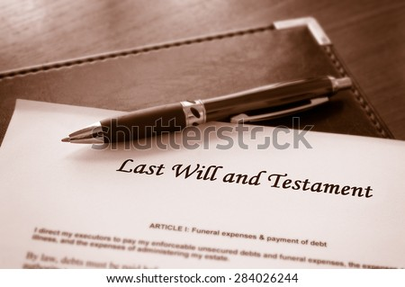 Last Will and testament document with pen - stock photo