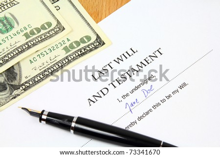 Last Will and Testament with a fictional name and signature. Document, US dollar money and fountain pen.