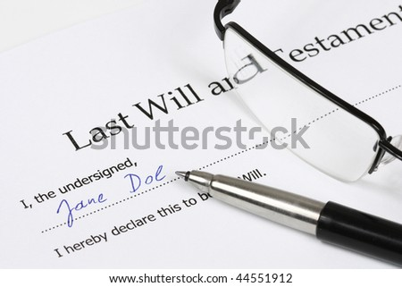 Last Will and Testament with a fictional name and signature. Glasses, document, pen.