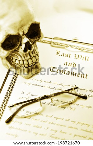 Last will and testament with skull and glasses in sepia monochrome - stock photo