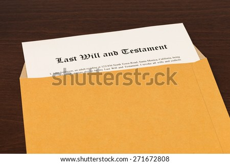 Last will on cream color paper with glasses and pen; document and information are mock-up