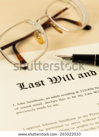Last will on cream color paper with glasses and pen; document is mock-up