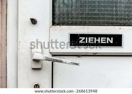 latch on an old toilet door, symbol of plumbing equipment, dirt, unkempt - stock photo