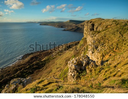 Late afternoon sun at Emmetts Hill, Dorset, UK and the fabulous view west along the Jurassic coastline towards Houns-tout Cliff, Swyre Head, Kimmeridge Bay and Worbarrow Bay.