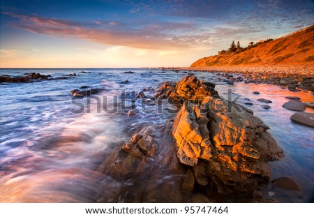 Late afternoon sun lights up Rocky Beach - stock photo