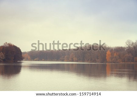 Late autumn at the river - stock photo