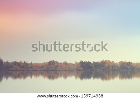 Late autumn at the river fog - stock photo