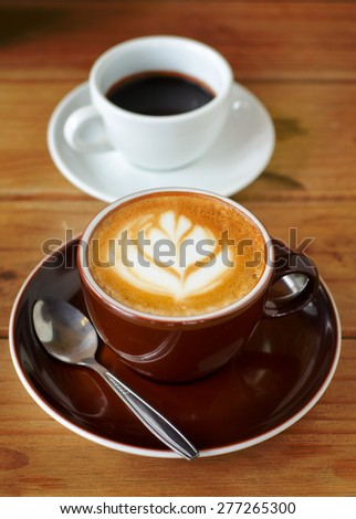 Late coffee, Coffee foam, Coffee cup in coffee shop - stock photo