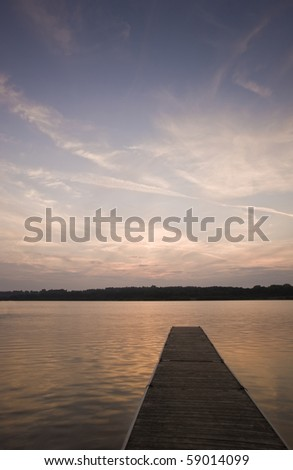 Late evening sunset with sun kissing horizon - stock photo