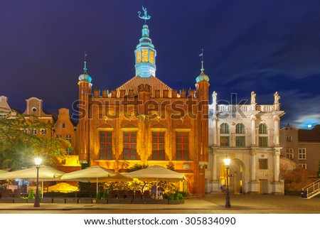 Late-gothic building of Brotherhood of St George and west side of Golden Gate in Gdansk Old Town at night, Poland