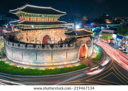 Late night traffic blurs past Paldalmun Gate in Suwon, South Korea. - stock photo
