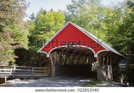 Late summer view of Pemigewasset River Covered Bridge in NH.