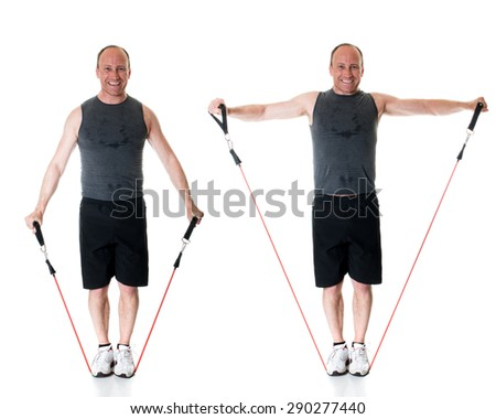Lateral raise exercise with resistance band. Studio shot over white. - stock photo