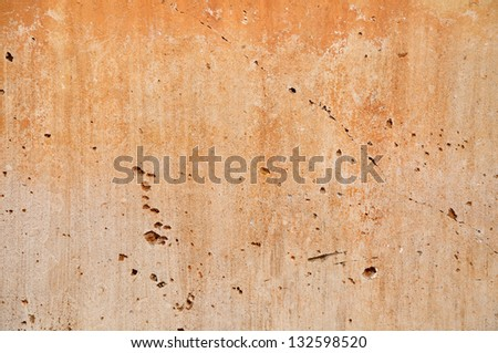 Laterite stained on the white exposed crack concrete wall. - stock photo