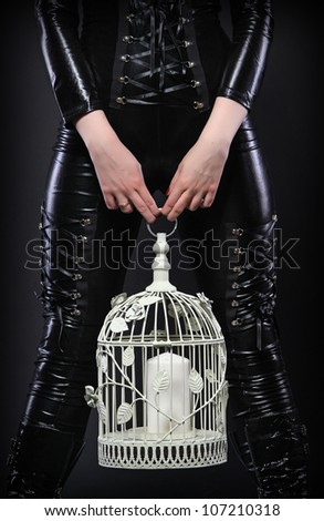 Latex woman with cage - stock photo