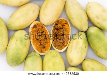 Latin American fruit called banana passionfruit (lat. Passiflora tripartita) (in Spanish mostly tumbo (Peru), curuba (Central America), taxo) which is used to prepare juice. Picture taken in Peru. - stock photo