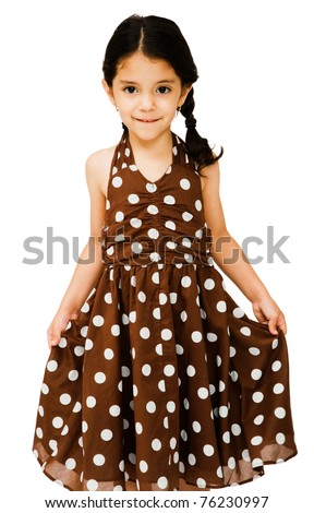 Latin American girl showing her dress isolated over white