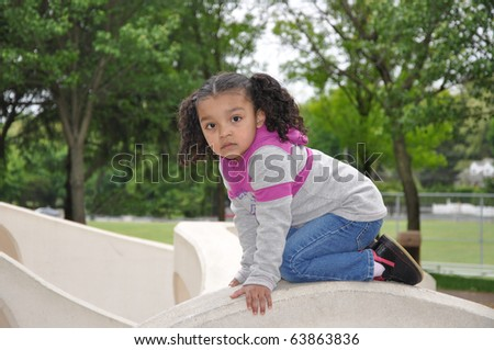 Latin Biracial Little Girl Climbing at  Recess Playground