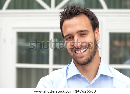 Latin business man smiling outdoors - stock photo
