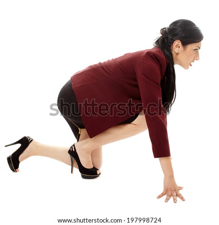 Latin businesswoman taking position for start in a race, isolated on white background - stock photo