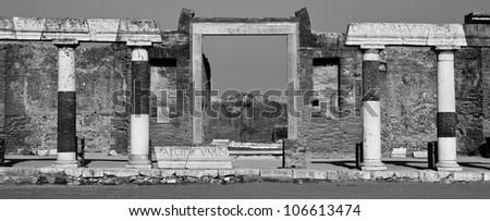 Latin engraved stone pillars in Pompeii ruins, Italy, Europe. black and White - stock photo