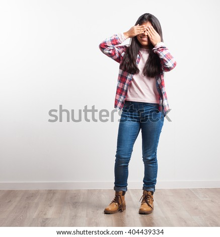 latin girl covering her face - stock photo