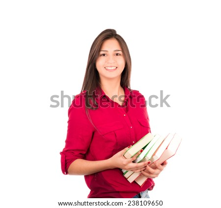 Latin Girl Holding a stack of big books. Smiling at the Camera.