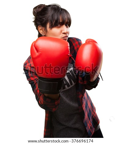 latin girl punching with red gloves